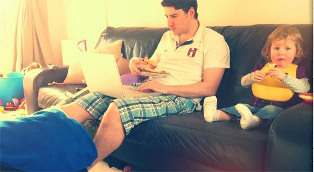 man-with-Laptop-on-sofa