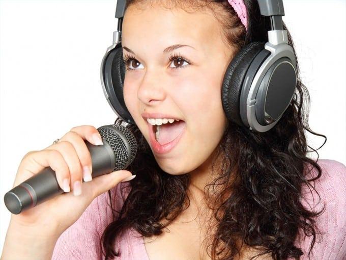 girl-holding-karaoke-mic-microphone-music-singer