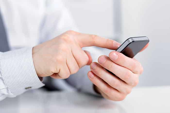 Businessman-Holding-A-Cell-Phone