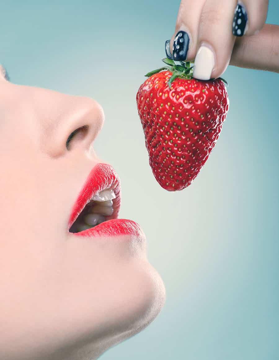 business women eating cherry