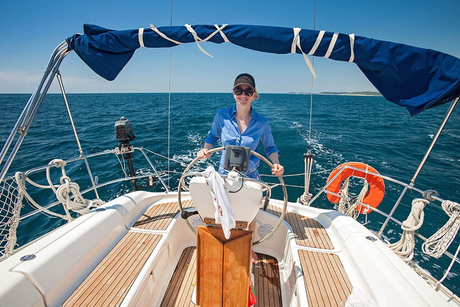 Young-woman-expat-on-boat