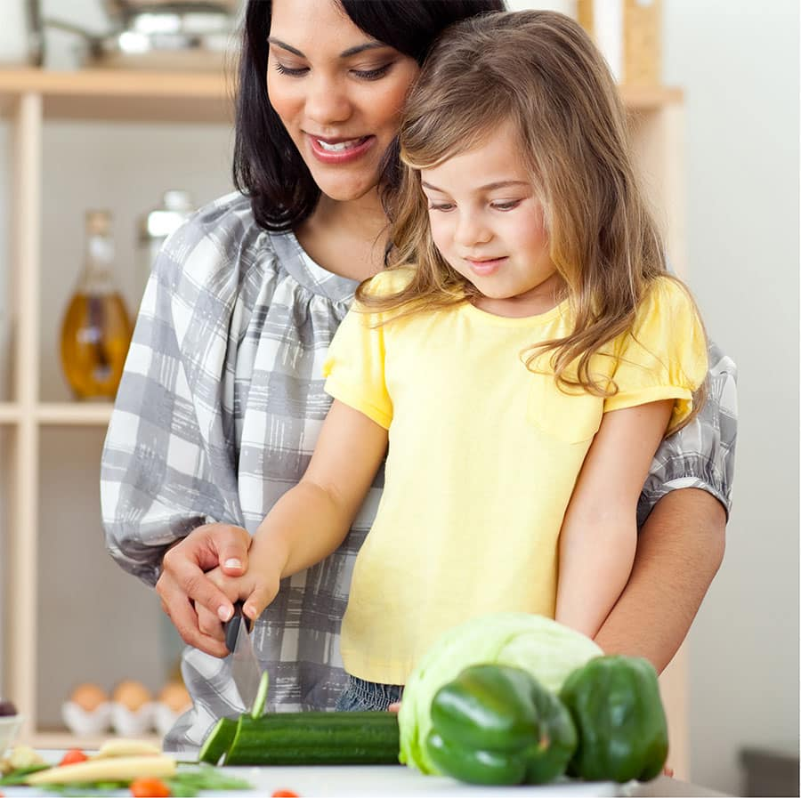 Mom Cooking with baby girl