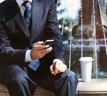 thought leader with a mobile phone Businessman
