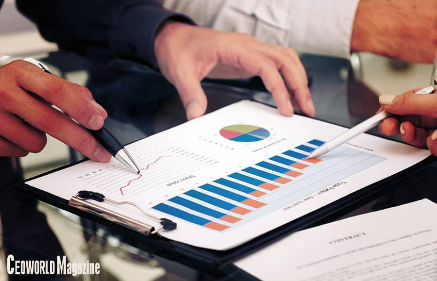 executives discuss the business analytics, Intelligence and Metrics process