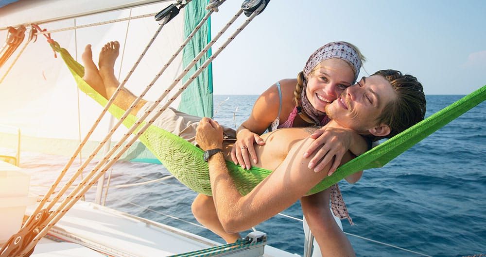 Young Couple Relaxing On A Yacht