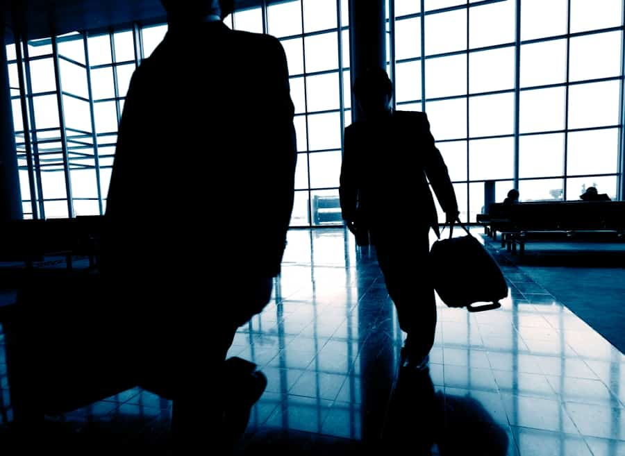 Business Tavelers At Airport