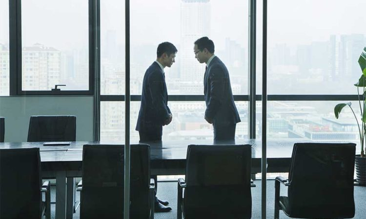 Businessmen Bowing to Each Other