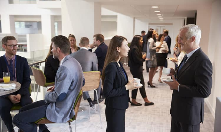 Delegates Networking At A Business Conference