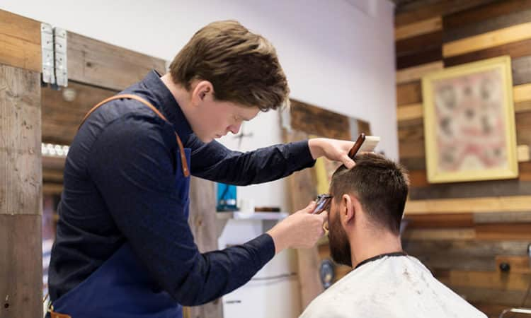 Man and barber at salon