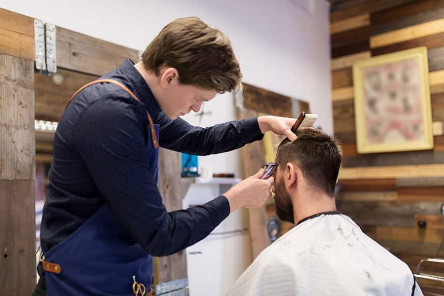 Man and barber at salon