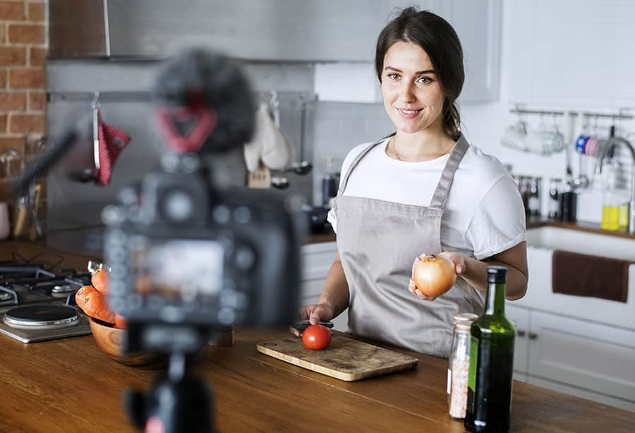 Social Media Influencers vlogger recording cooking