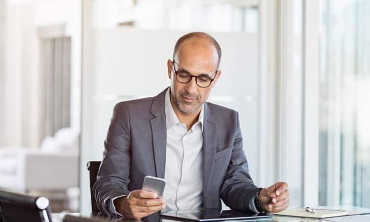 Businessman working on phone