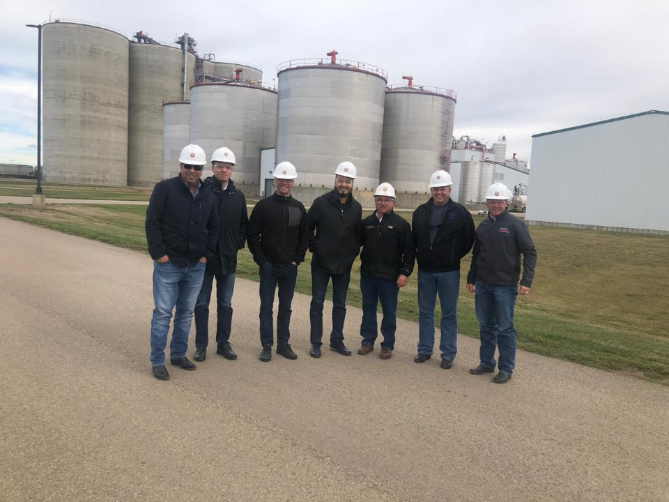 Yerkin Tatishev, center, Daniel Kunin, third from the left, and members of Kusto Group visit a farming operation in the United States