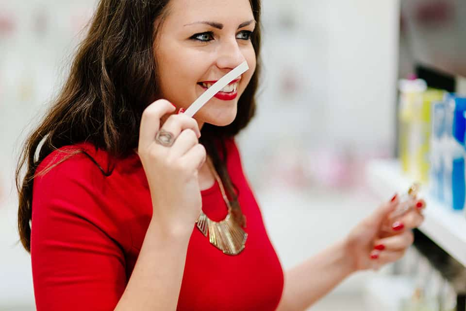 woman testing perfumes